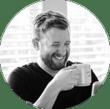 Jon Phillips Matchless Web Studio smiling holding coffee mug
